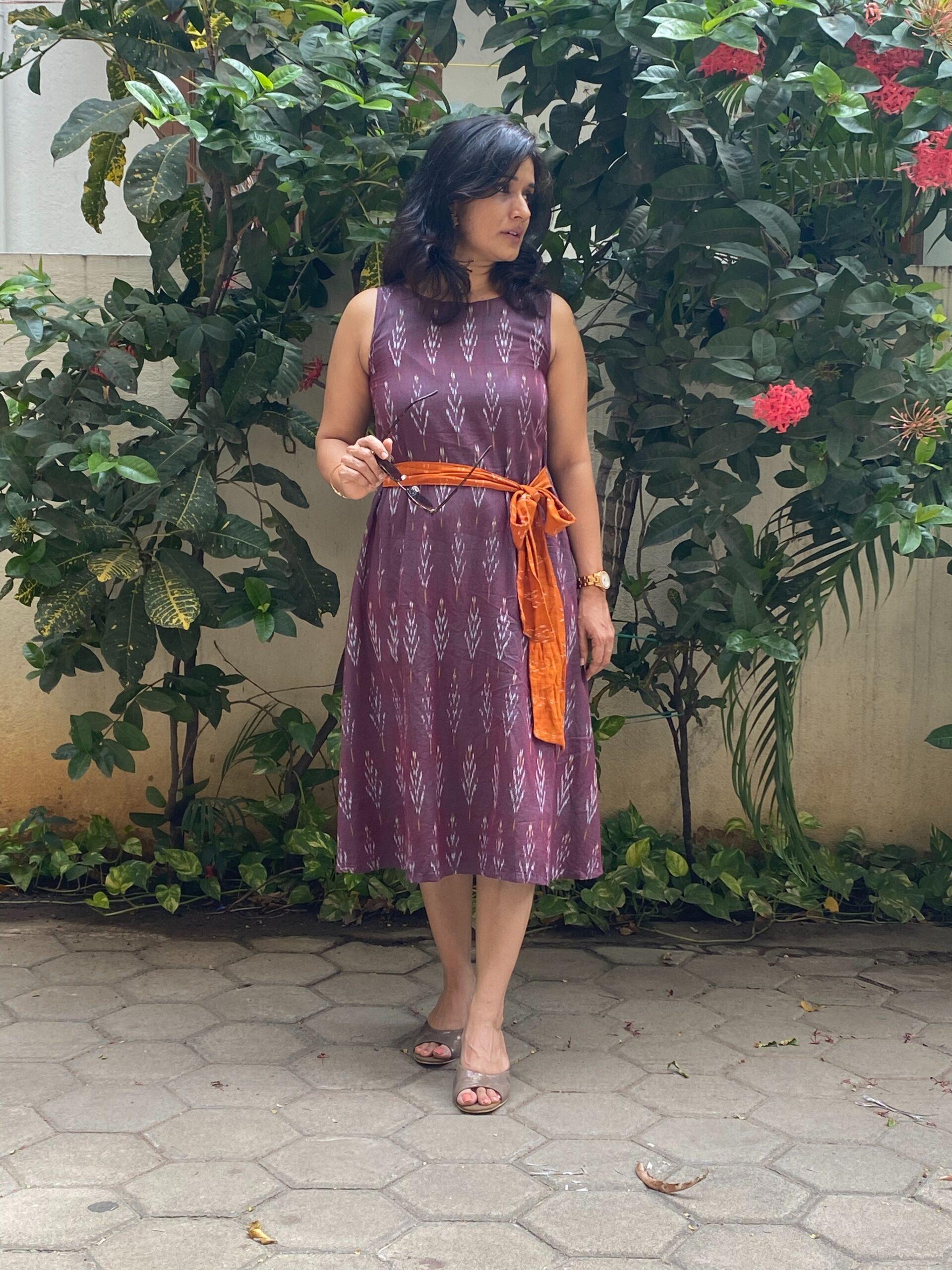 Purple ikkat dress with an orange belt